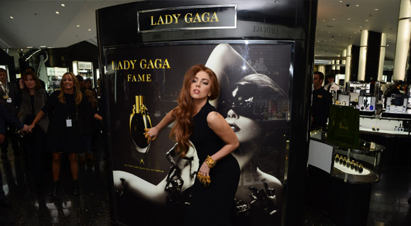 Lady Gaga poses in front of the graphics printed by Blue Moose